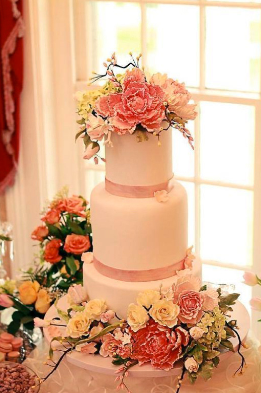 Pale Pink Tiered Cake Topped with Ruffled Sugar Flowers