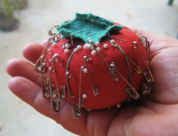 Red Pincushion with Pins and Needles