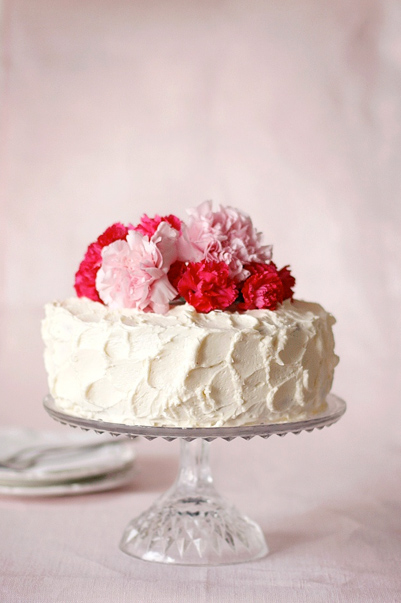 White Cake Topped with Fresh Carnations