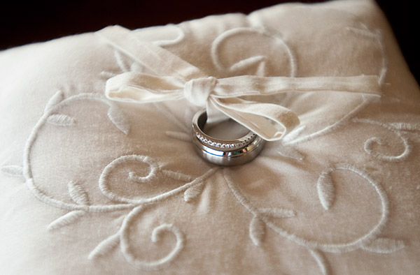 Shot of Wedding Ring on a White Pillow