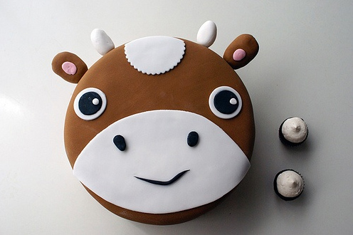 Cow Cake with Accompanying Cupcakes