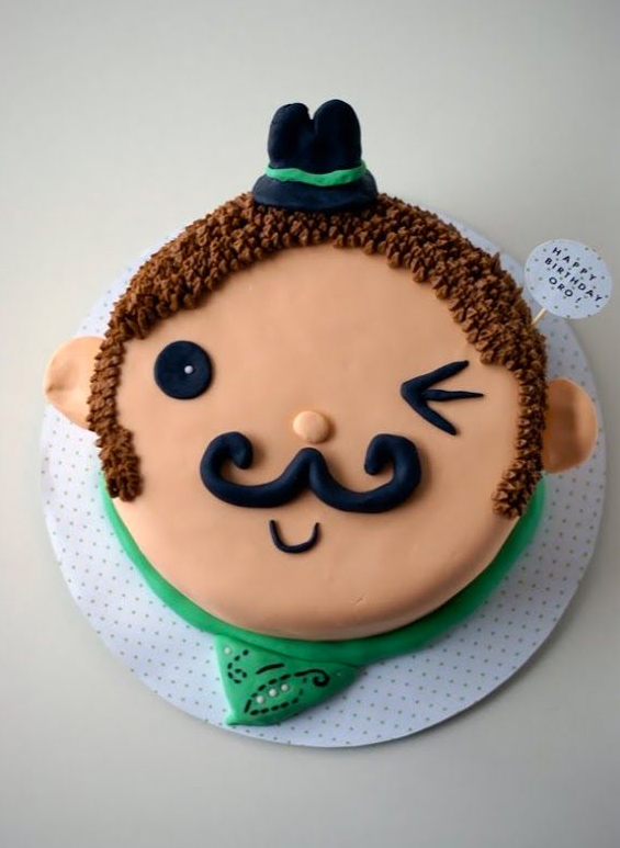 Cake Decorated as Mustached Man's Face