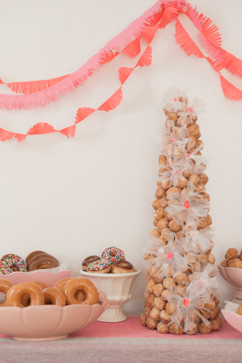 Table with Doughnut-hole Cake and Doughnuts