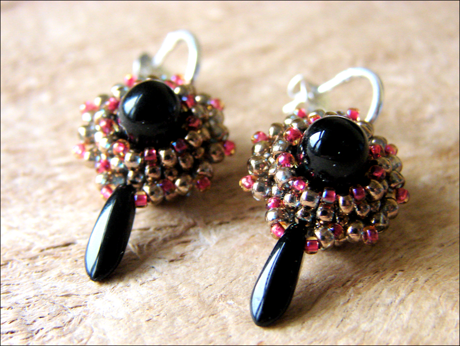 Two Earrings Featuring Beads