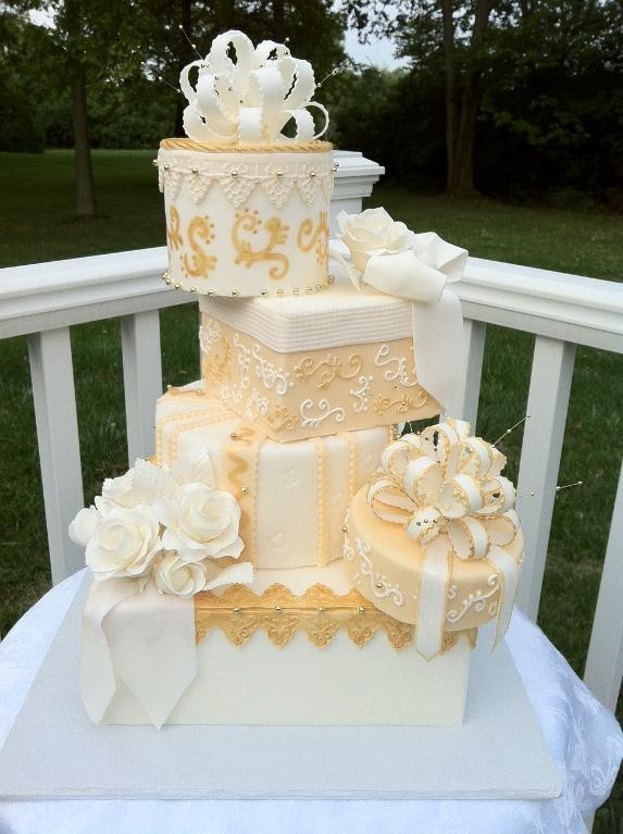 White Tiered Cake with Gold Embossing and Details