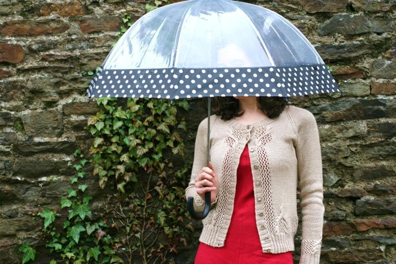 Akoya Cardigan, Modeled by Woman with Umbrella