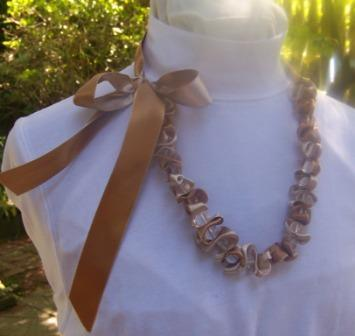Large Bead and Ribbon Necklace on Stand