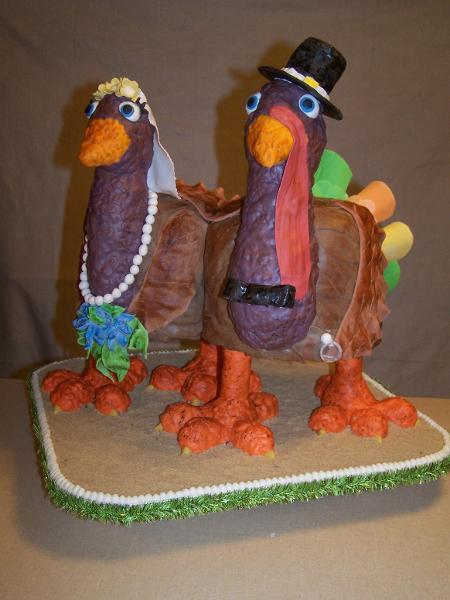 Cake Carved as Girl and Boy Turkeys