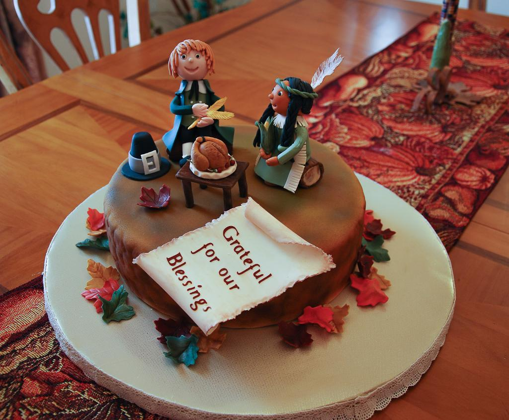 Cake Topped with Fondant Pilgrim and Native American