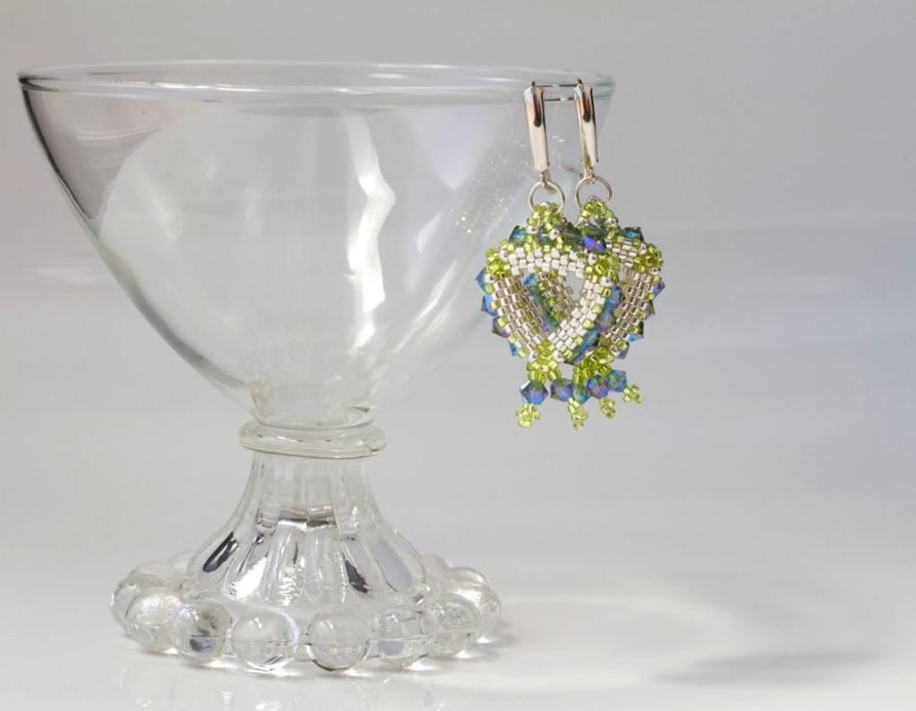 Pair of Beaded Earrings Hanging from a Glass Bowl