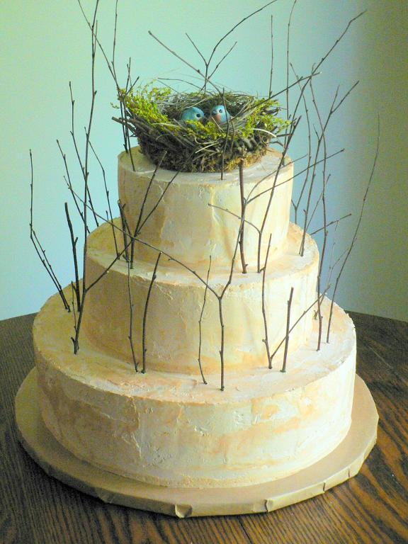 Woodland-Themed Wedding Cake Topped with Bird's Nest