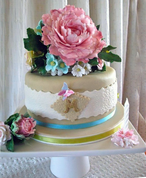 Tiered Gold and White Cake Topped with Exquisite Blossom