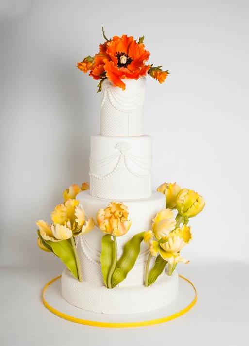 Tiered White Cake Topped with Orange and Yellow Sugar Flowers