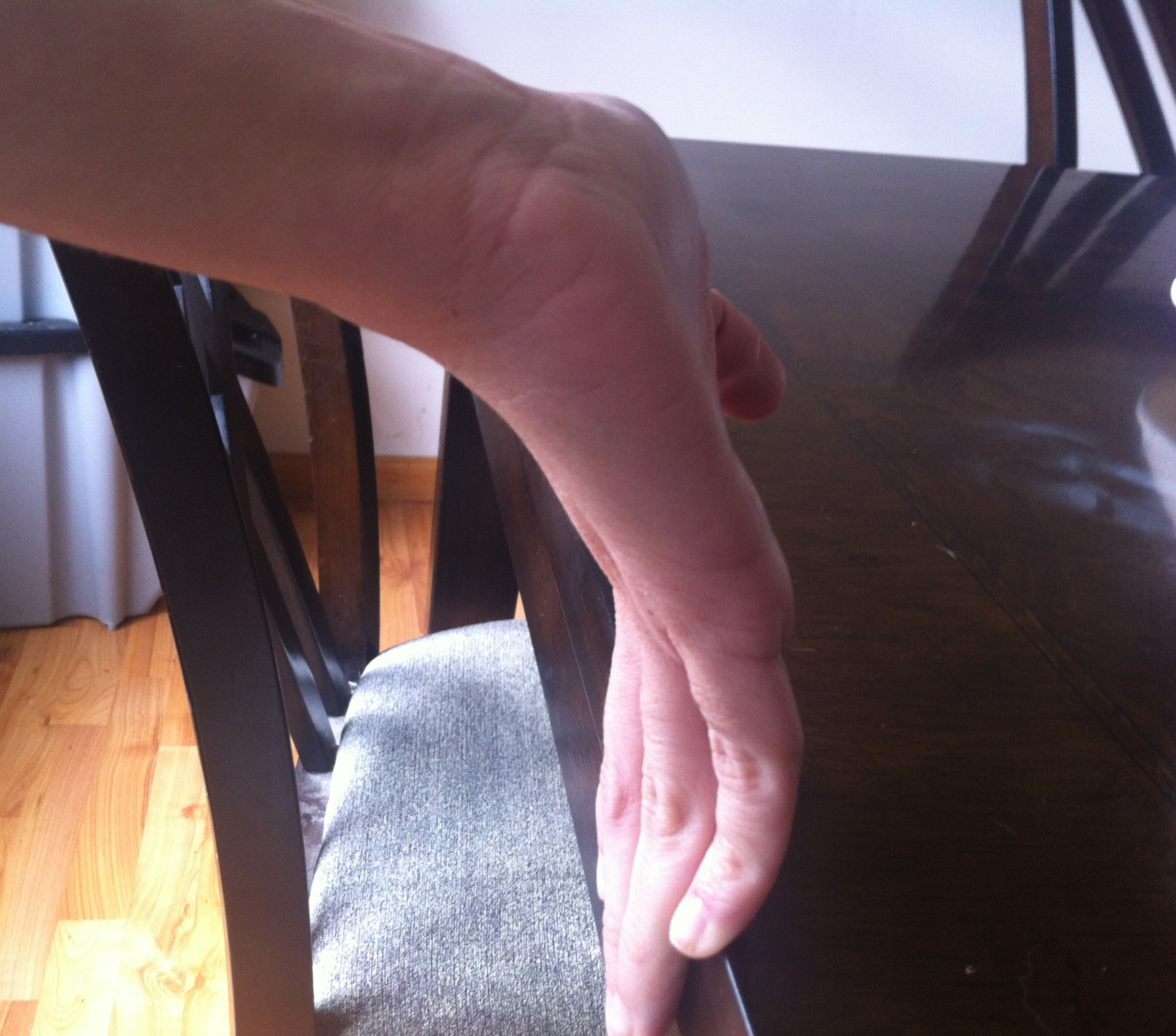 Stretching Hand Against Table