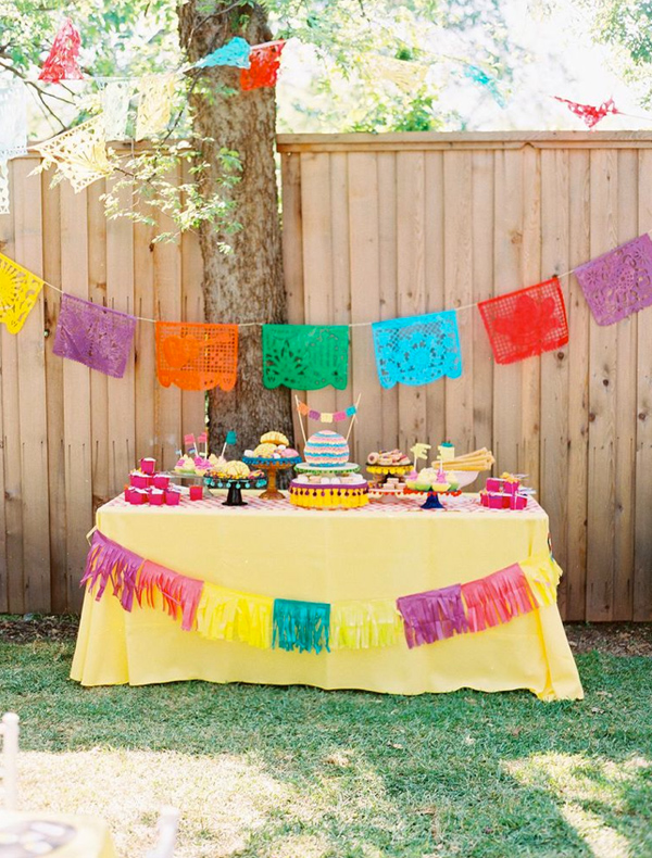 Outdoor Fiesta Dessert Table with Colorful Flags
