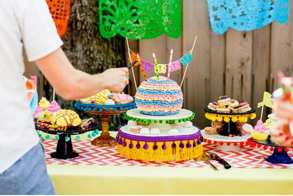 Lighting Candles on Cake on Fiesta Dessert Table