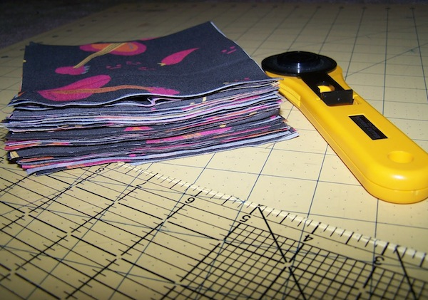 Cutter and Fabric Stack on Gridded Surface
