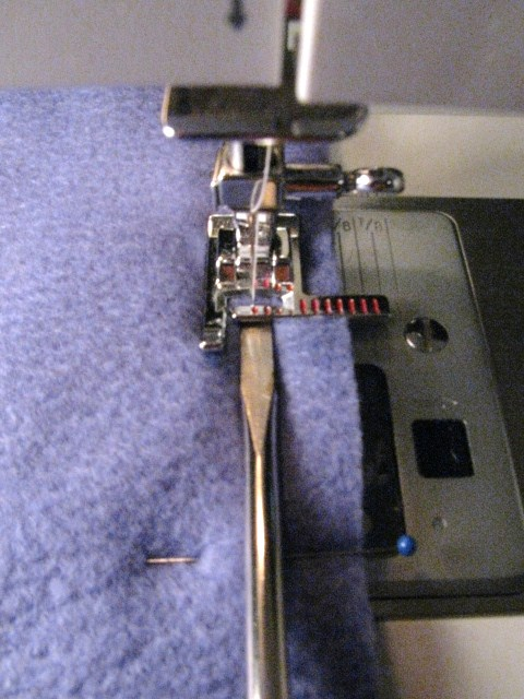 Close Up on Using Screw Driver While Sewing