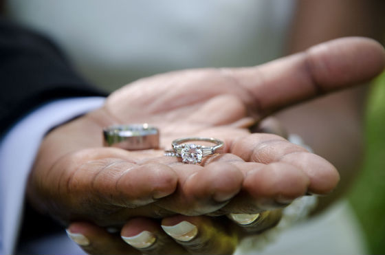 Rings Being Held in Man and Woman's Hands