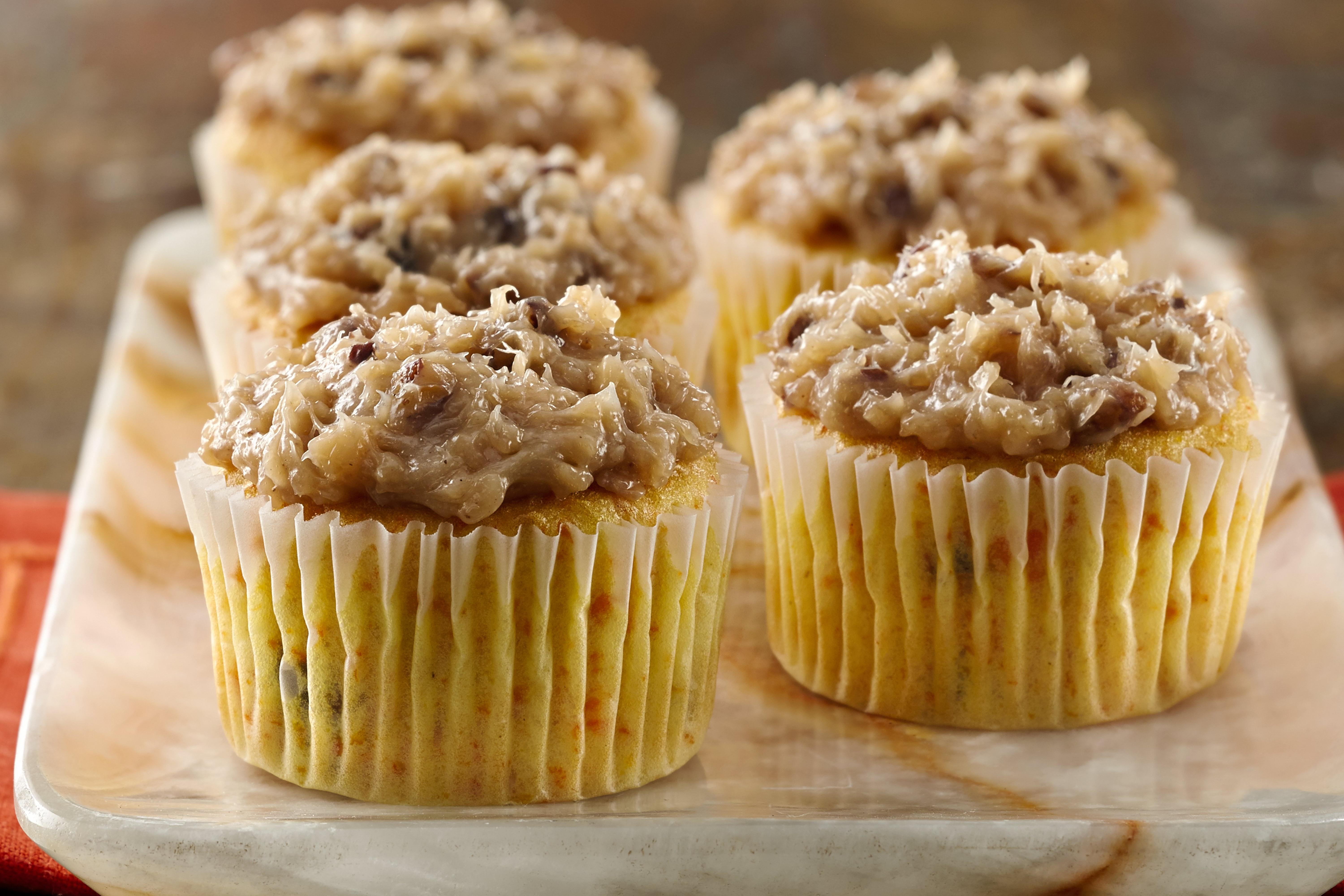 Carrot Cupcakes Topped with Coconut-Pecan Frosting