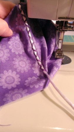 Couched rat tail cord using decorative stitch