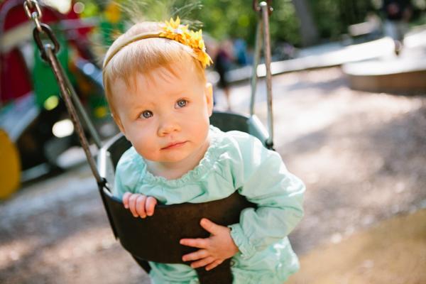 Little Girl in Swingset