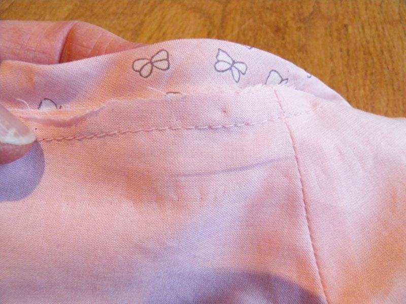 Machine stitched bias binding to neckline