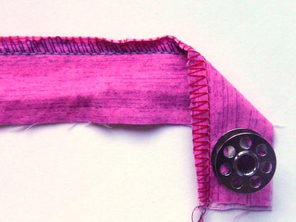 Upper looper tension too tight, 3 thread overlock