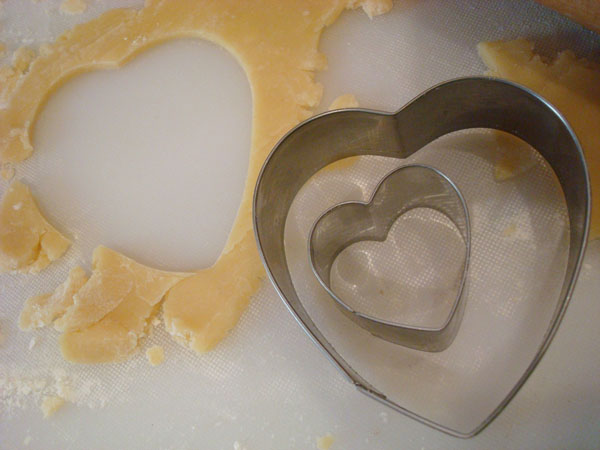 Cutting Dough with Heart Cookie Cutters