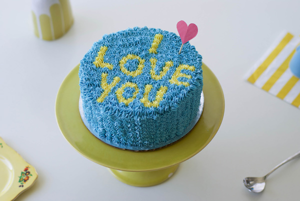 "Blue Piped Cake Reading ""I Love You"""
