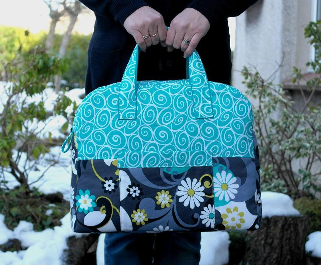 Woman Holding Blue Patterned Travel Bag
