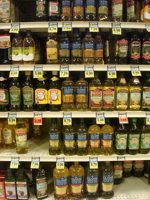 Rows on Bottles of Olive Oil on Store Shelves