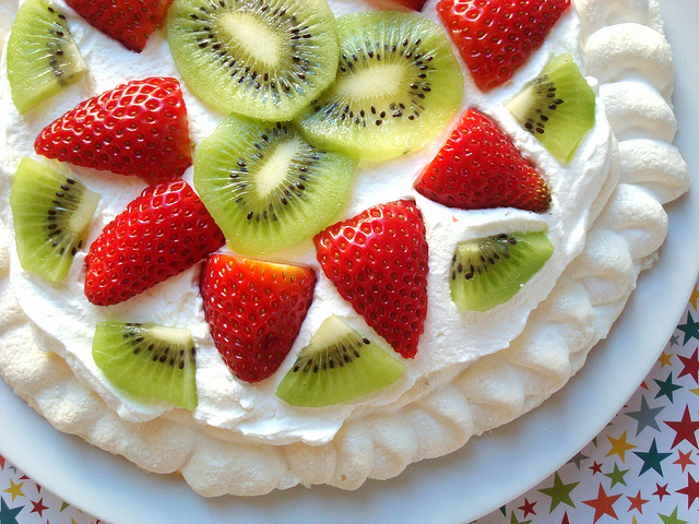 Adding Fruit to Top of Pavlova