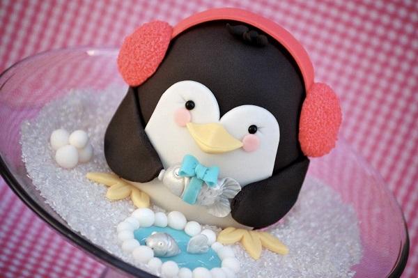 Penguin-Shaped Cake Wearing Earmuffs
