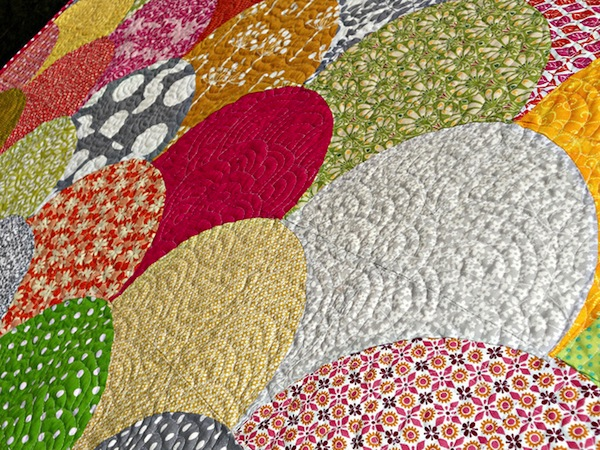 Colorful Patterned Clamshell Quilt