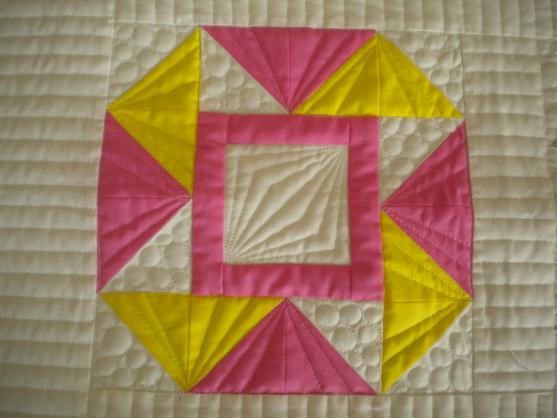 Quilt with Yellow and Pink Half Square Triangles
