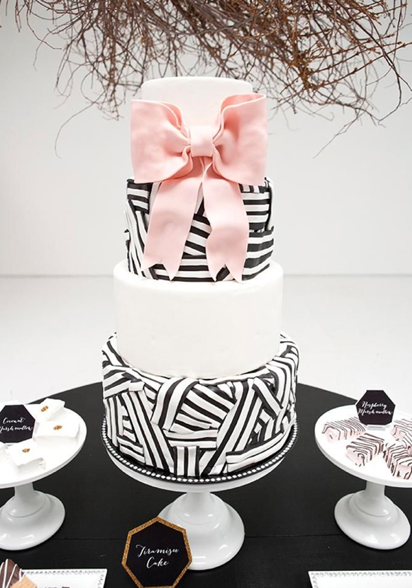 Tiered Black and White Cake with Large Pink Bow