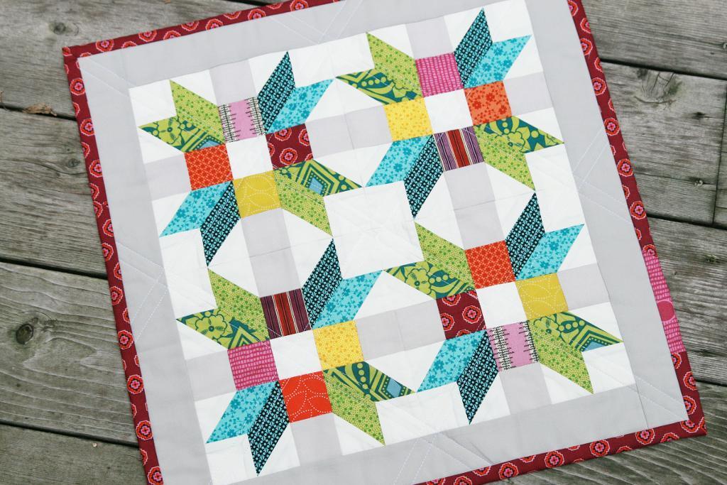 Mini Quilt with Colorful Poinsettia Design - www.craftsy.com