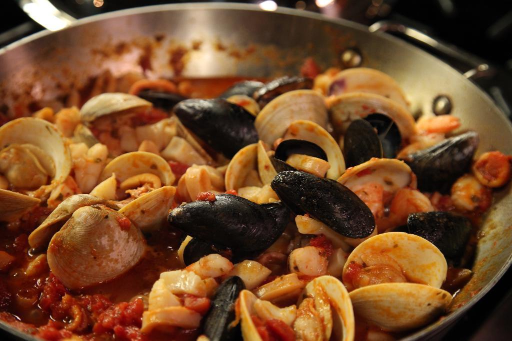Italian Seafood Sauce Cooking in Pan