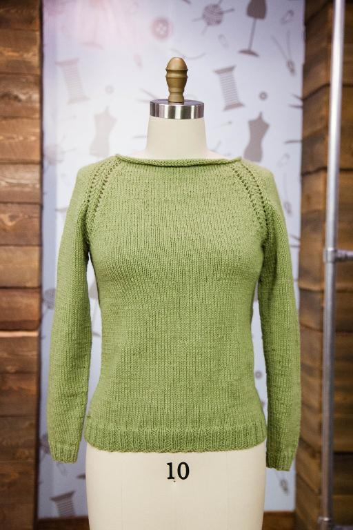 Green Knit Sweater on a Mannequin