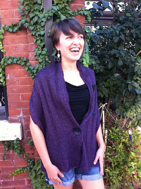 Knitted wrap with button