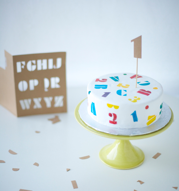 White Cake Painted with Stenciled Numbers