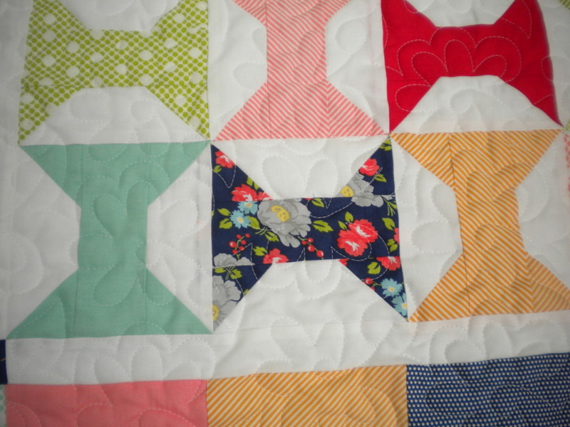 Quilt Featuring Patterned Bowtie Design