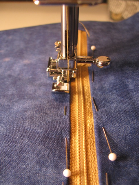Machine Sewing the Zipper into the Opening