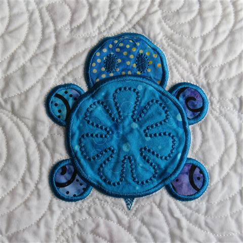 Quilt Featuring Turtle Done with Machine Embroidery