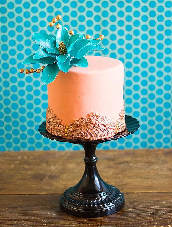 Pink Cake with Blue Fondant Flower and Lace