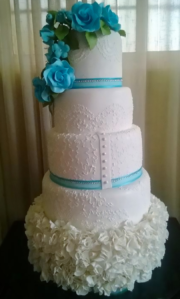 Tiered White Cake Covered with Blue Flowers