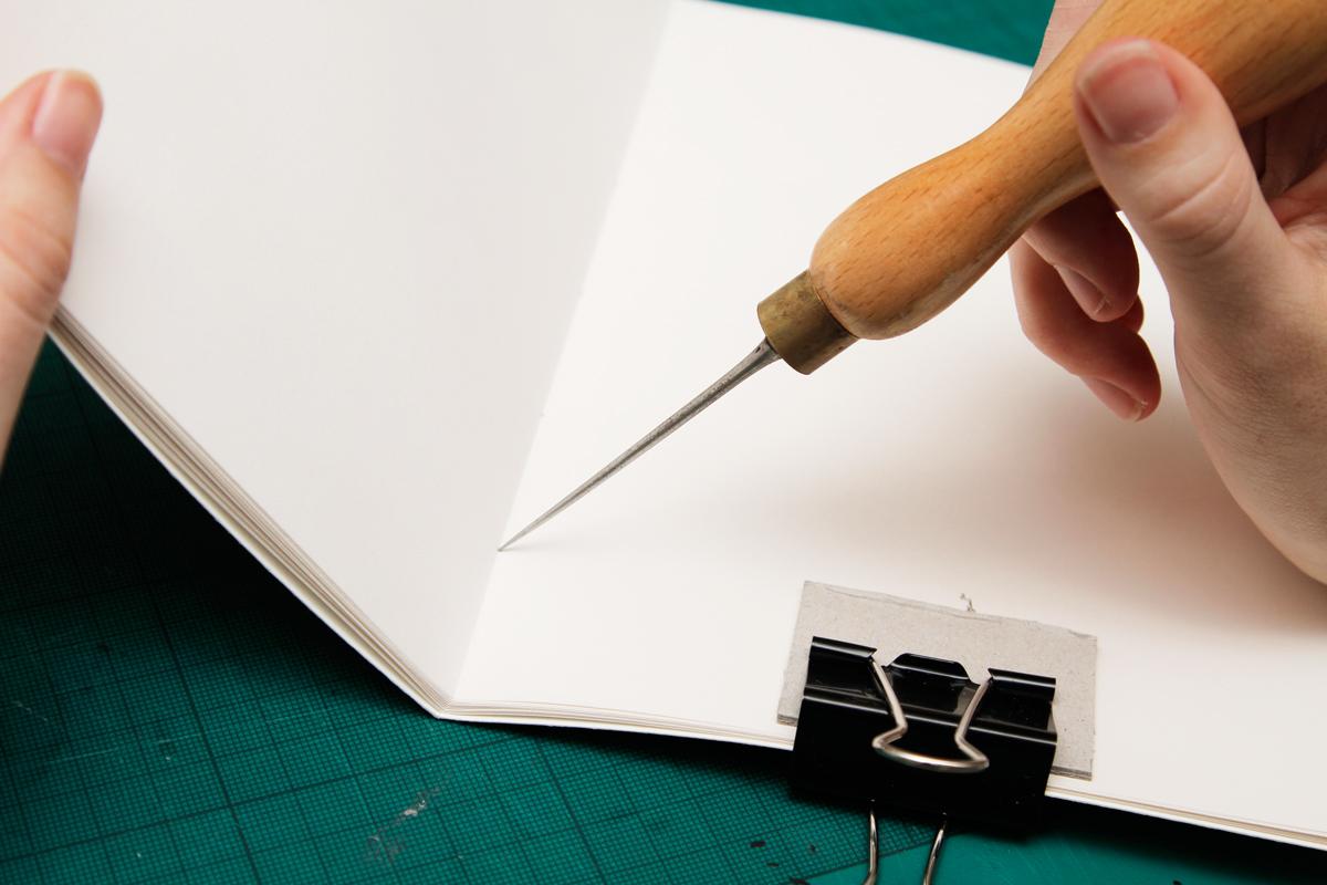 DIY Sketchbook piercing holes