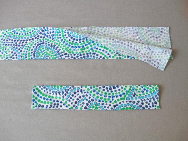 Dobla la tela de la diadema por la mitad