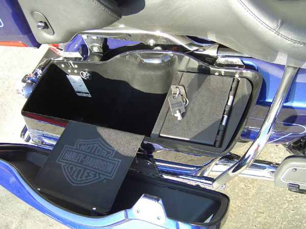 Companies such as Corporate Travel Safety make motorcycle-specific gun vaults.